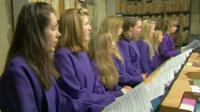 Girls rehearse for choir performance