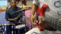Musicians rehearsing in prison