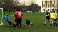 Footballers at goal