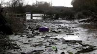 """Debris washed up by flood water is seen at James Winslade""""s farm in Moorland on January 28, 2014 in Somerset, England"""