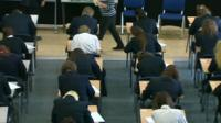 School pupils taking exams