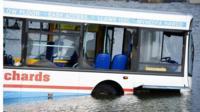 Semi-submerged bus