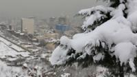 The Iranian capital Tehran covered in snow