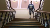 Gregg Stevenson using the stairs with prosthetics