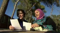 Ruth Ebenstein and Ibtisam Erekat look at photographs