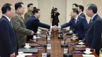 South Korean chief delegate Kim Kyou-hyun, second from right, shakes hands with his North Korean counterpart Won Tong Yon, third from left