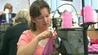 Woman working at swing machine