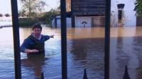 Jon Kay in floodwaters in Somerset