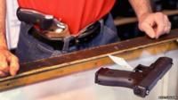 Dan Egar helps a customer shop for a handgun on February 13, 2014 in Tinley Park, Illinois