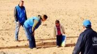 UNHCR image of little Syrian boy Marwan apparently 'alone' in the desert
