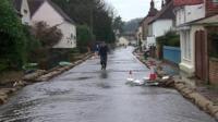 Man walking down flooded street