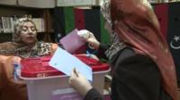 A woman voting in Libya