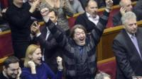 "Ukraine""s opposition members react during a Parliament session in Kiev"