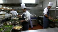 Workers in a kitchen