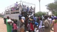 New arrivals climbing off truck