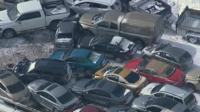 Cars in section of pile-up