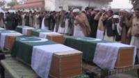 Coffins draped in the Pakistani flag