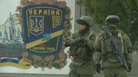 Soldiers in front of mural, Crimea