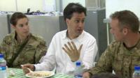 Ed Miliband with two soldiers