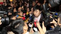 A relative answers media questions at Lido Hotel in Beijing