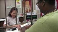 Woman at pawn shop