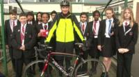 Group of School reporters and a cyclist