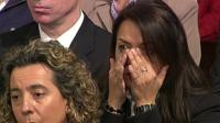 A mourner wipes away tears at a service in Madrid to mark the 10th anniversary of train bomb attacks