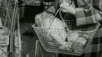 archive film of woman shopping