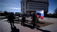 Man with Russian flag in Crimea