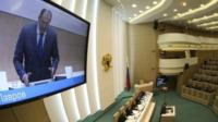 Russia' Foreign Minister Sergei Lavrov speaks to members of the Federation Council