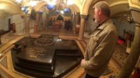 Man looking at a memorial