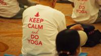 "NRI conference in London, with a t-shirt saying ""keep calm and do yoga""."