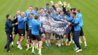 Leicester City players celebrate promotion to Premier League