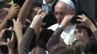 Pope Francis poses for selfies with crowds in Rome