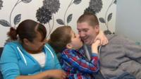 Adrian with foster parents