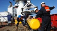 This handout image taken on 1 April 2014 and received on 10 April 2014 from the US Navy shows the Bluefin 21 being hoisted back aboard the Ocean Shield