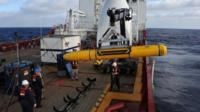The Bluefin-21 being moved into position in the Indian Ocean