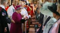 The Queen presenting the specially minted coins