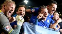 Leicester City players celebrate winning the Championship title