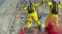 View as sky divers jump from Burj Khalifa