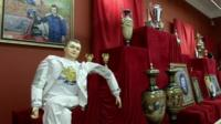 art including Yanukovich doll and portraits