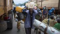 A Muslim man in Bangui prepares to be evacuated by road