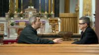Giles Dilnot and John McTernan in church