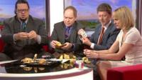 Magicians Penn and Teller do a magic trick on the BBC Breakfast sofa