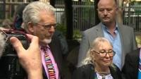 Rolf Harris and his wife arriving at court
