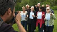 Relatives with Trusted in Care reports having photograph taken