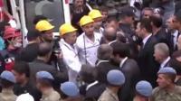 Recep Tayyip Erdogan meets rescuers