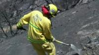 Firefighter clearing fire damage