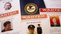 Press materials are displayed on a table of the Justice Department in Washington 19 May 2014