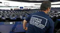 A man visits the plenary room of the European Parliament in Strasbourg